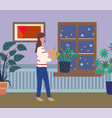 woman at home caring for plants watering flora vector image vector image