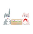 easter bunnies and easter eggs in wooden box for vector image vector image
