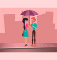 Cute lovely couple holding colorful umbrella