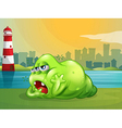 A fat green monster across the lighthouse vector image