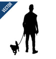 silhouette a man with a dog vector image