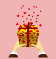 gift box in men hands with flying hearts vector image vector image