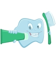 Tooth holds toothpaste and toothbrush vector image