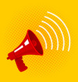 red megaphone on yellow background vector image vector image