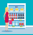 woman in supermarket refrigerator with products vector image