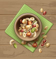 different nuts in bowl vector image vector image
