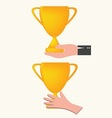 hand holding trophy vector image
