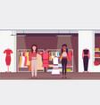 mix race saleswomen holding dresses fashion vector image