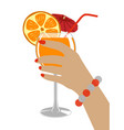 a glass of fresh orange juice in hand vector image vector image