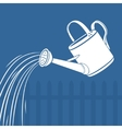 Watering can watering the earth vector image
