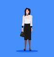 attractive businesswoman holding handbag standing vector image vector image