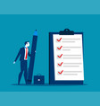businessman checklist on the clipboard vector image vector image