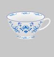 decorative porcelain tea cup ornate with blue vector image