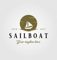 vintage sailboat with sun or moon logo vector image