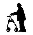 old disabled woman using a walker silhouette vector image vector image