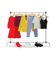 clothes hanger with casual woman clothes footwear vector image vector image