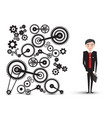 successful young businessman in suit with cogs - vector image vector image