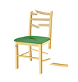 Broken wooden chair with green seat