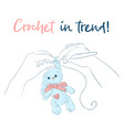 hands with a crochet hook bunny handmade vector image vector image
