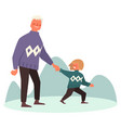 dad and son walk outdoors on winter day holding vector image