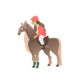 kid girl rider in pink form on horseback riding vector image
