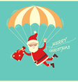 Santa Claus on parachute flying on blue background vector image vector image