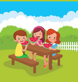 children eat a watermelon in the backyard in the vector image