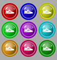 Sneakers icon sign symbol on nine round colourful vector image vector image