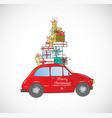 christmas card with vintage red car carrying gift vector image vector image