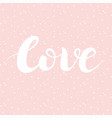 Love lettering on pink background with white dots