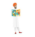 successful hindu businessman reading magazine vector image vector image