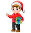cartoon of kid boy holding a christmas gift vector image vector image