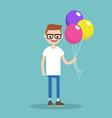 young nerd holding a bunch of colourful balloons vector image
