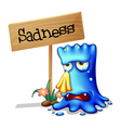 A very sad blue monster crying near a wooden vector image vector image