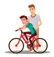 father teaches his son to ride a bicycle vector image