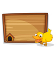 A duck beside an empty wooden board vector image vector image