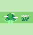 earth day banner of hands holding green planet vector image