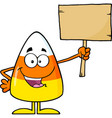 funny candy corn holding a wooden board vector image vector image