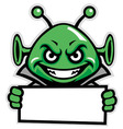 martian green mascot hold a sign vector image