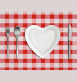 heart shaped plate fork spoon and knife top view vector image