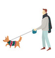 man walking with dog on leash in similar colored vector image vector image