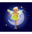 A fairy holding a wand in front of the crescent vector image vector image