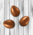 Easter chocolate three eggs on grey wooden vector image