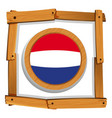 netherlands flag in wooden frame vector image vector image