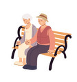 old couple sitting on a bench