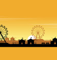 silhouette of amusement park with orange sky vector image vector image