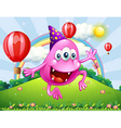 A happy pink beanie monster jumping at the hilltop vector image vector image