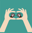 two hands holding cute cat dog paw print love and vector image vector image