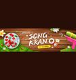 songkran festival thailand bowl gun water on wood vector image vector image