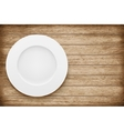 Empty plate on wooden table vector image vector image